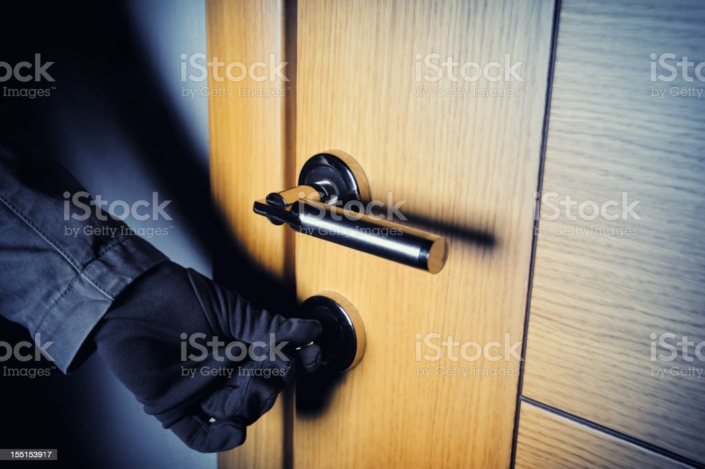 Gloved hand opening the door stock photo