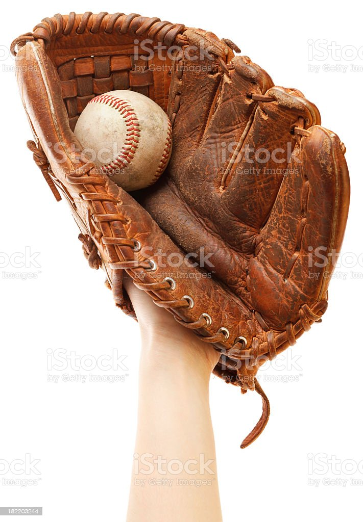 Gloved hand raised to catch baseball stock photo