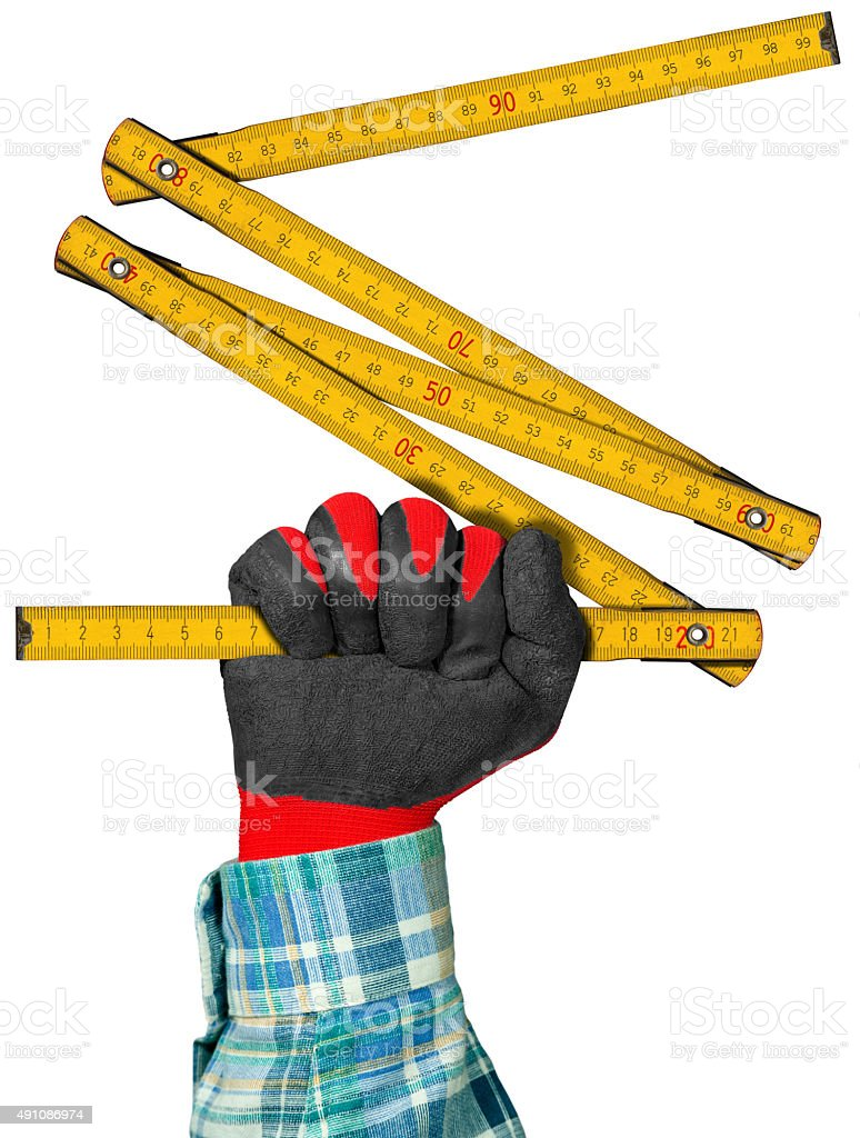 Gloved Hand with Wooden Folding Ruler stock photo