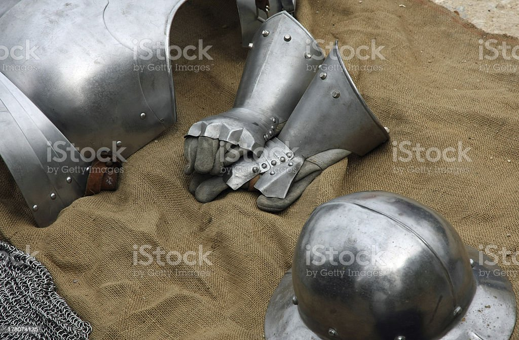 gloves and metal armor with a helmet royalty-free stock photo