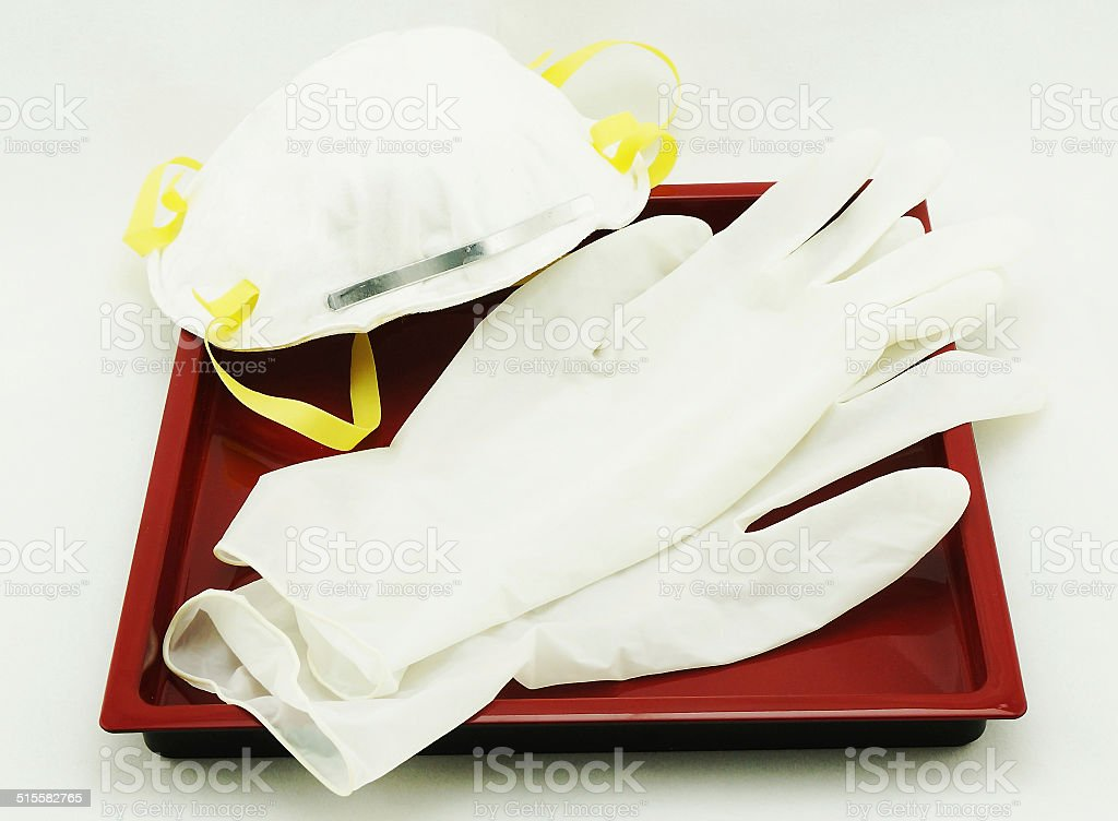 Gloves and protective mask stock photo