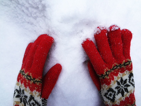 Red gloves in snow