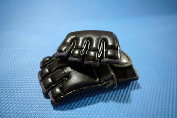 mma gloves - sports glove stock photos and pictures