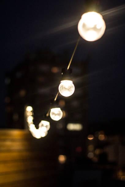 glow - terrassen lichterketten stock-fotos und bilder