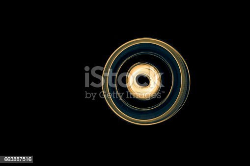 96824512istockphoto Glowing abstract curved blue and yellow lines 663887516