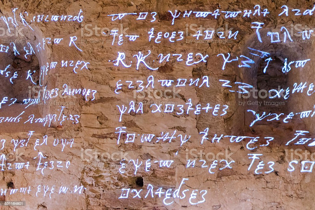 Glowing antique runic characters and letters of words stock photo