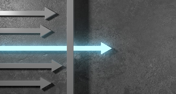 Glowing arrow breaking through wall on concrete background. Breakthrough and growth concept.