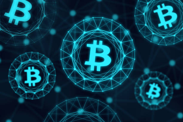 Glowing bitcoin signs on dark background stock photo
