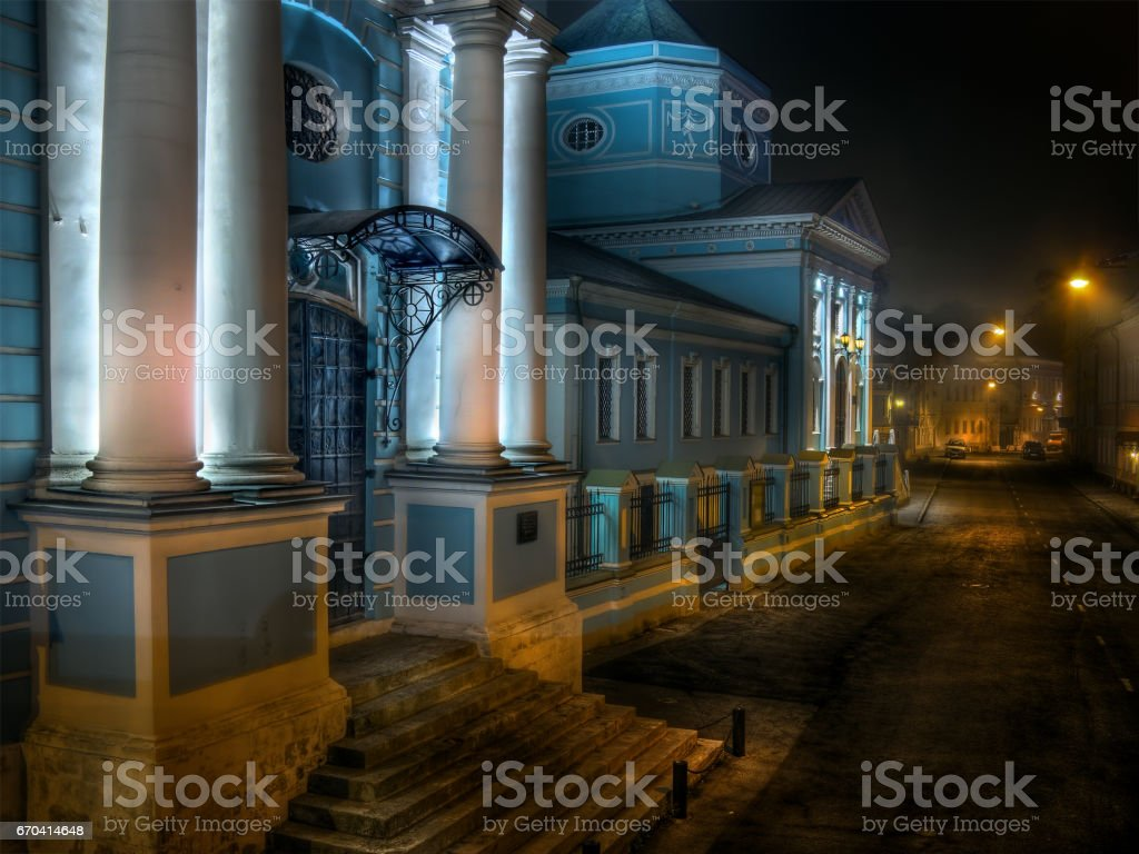 Glowing blue church and street in Moscow with night illumination stock photo