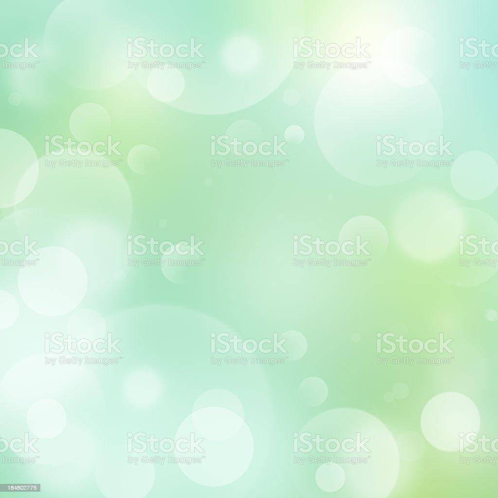 Glowing bubble background in muted green tones royalty-free stock photo