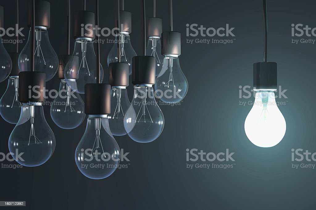 glowing bulb among the gray stock photo