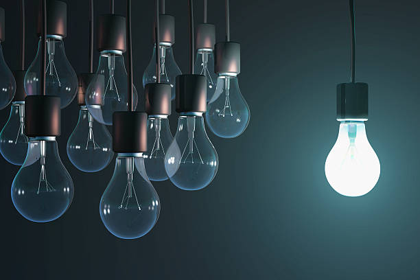 glowing bulb among the gray glowing bulb among the gray intellectual property stock pictures, royalty-free photos & images