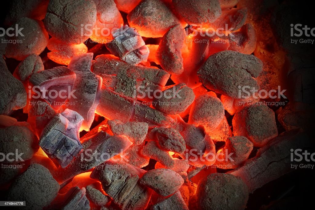 Glowing Charcoal Briquettes Background Texture stock photo