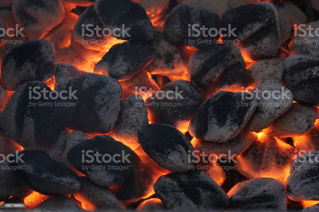 Glowing charcoal briquettes stock photo