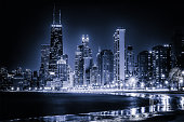 Blue tinted time lapse view along Chicago's curving lakeshore. Surreal view.