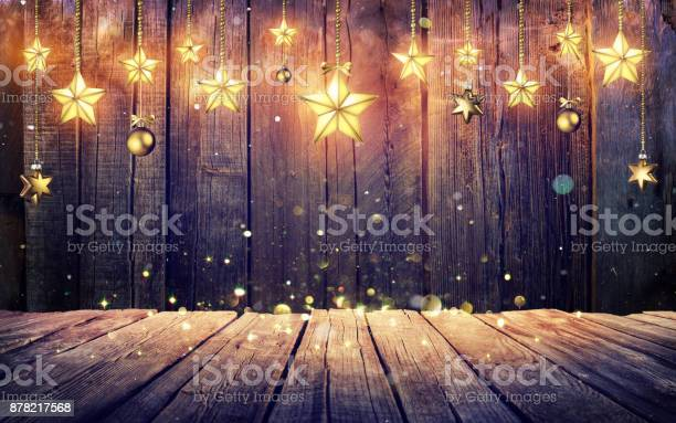 Glowing christmas stars hanging at rustic wooden background picture id878217568?b=1&k=6&m=878217568&s=612x612&h=3z2hpb6a1evxs2ojbiu2fs3geiocerm7geoitbg3saw=