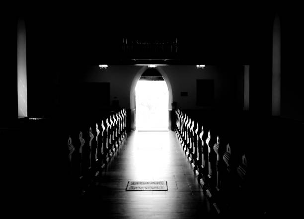 Glowing Church Aisle, Pews Illuminated B&W  pew stock pictures, royalty-free photos & images