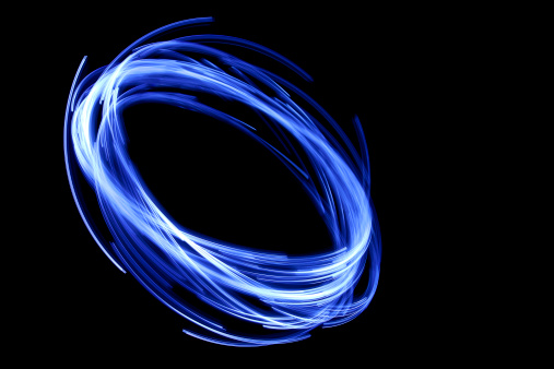 istock glowing circular blue, long exposure of creative light painting 172478954
