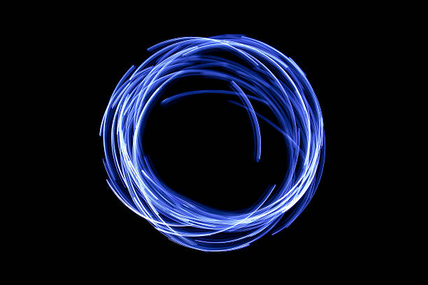 glowing circular blue, long exposure of creative light painting stock photo