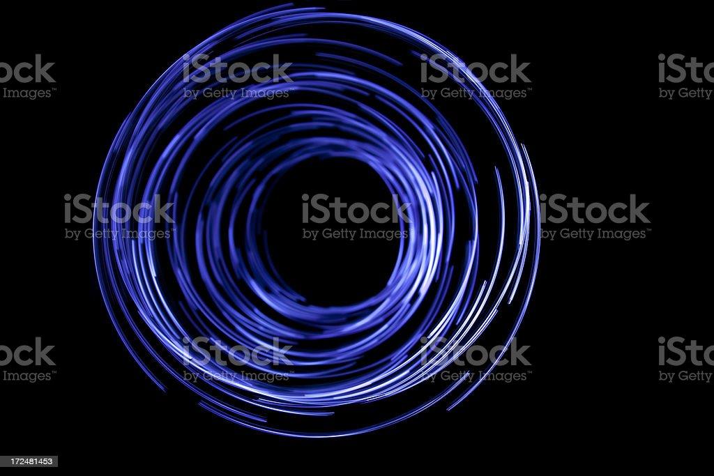 glowing circular blue, long exposure of creative light painting stock photo