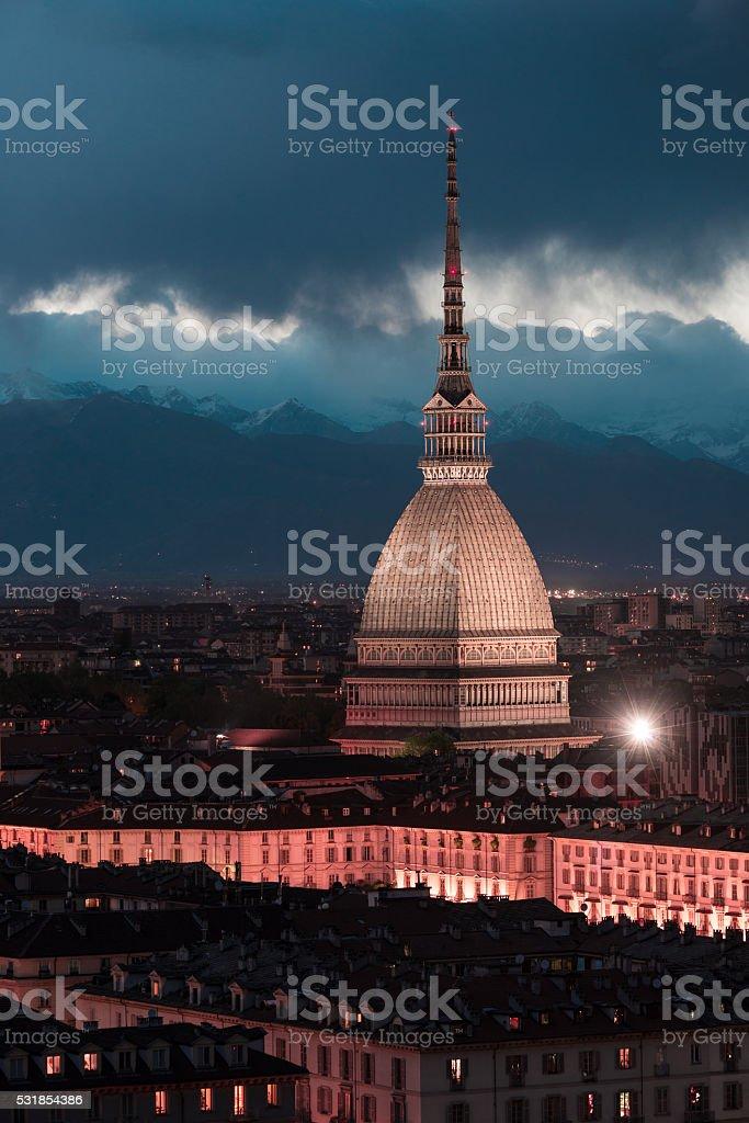 Glowing cityscape of Torino (Turin, Italy) at dusk, toned image stock photo
