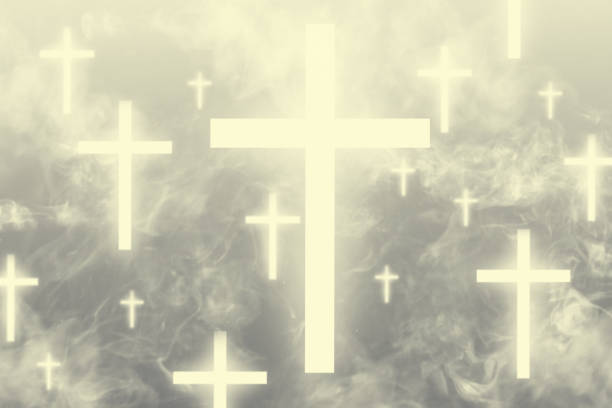 Glowing crosses floating in the heavens surrounded with light clouds stock photo