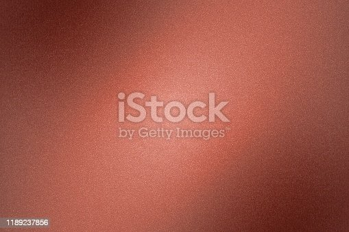 Glowing dark red foil metallic wall surface, abstract texture background