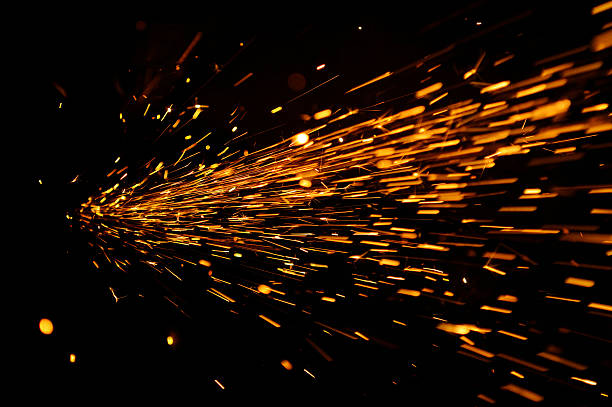 Glowing Flow of Sparks in the Dark stock photo