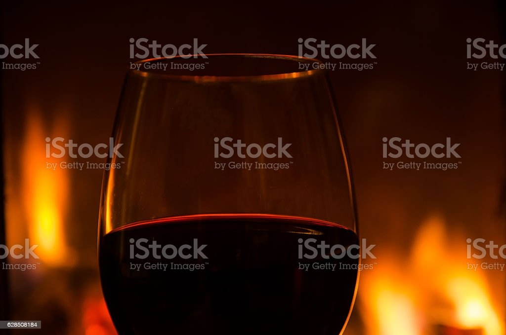 Glowing glass of red wine detail stock photo