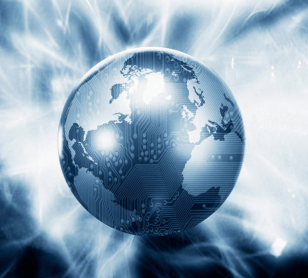 Glowing globe with microchip overlay stock photo