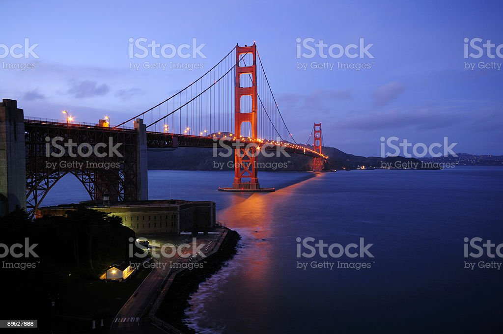 Glowing Golden Gate Bridge and Fort Point royalty-free stock photo