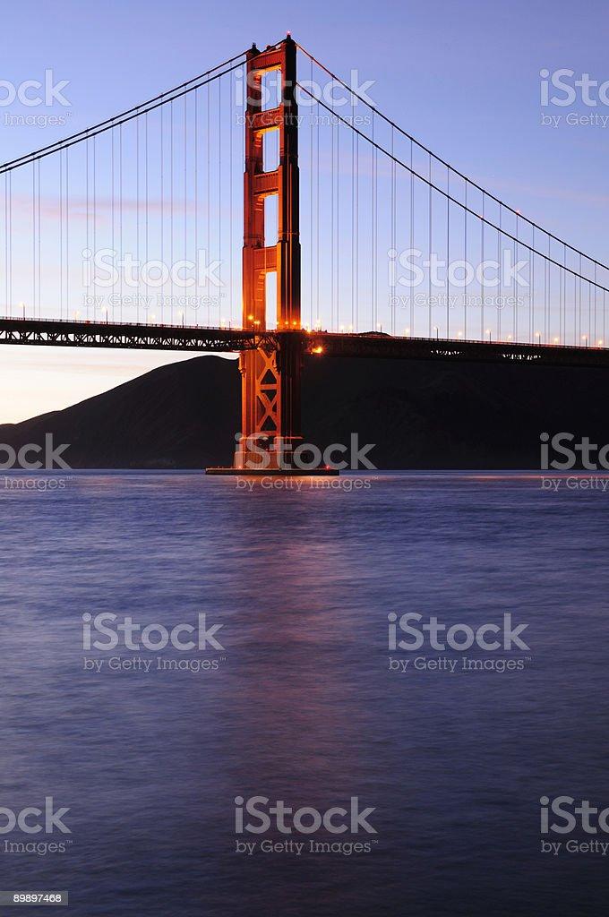 Glowing Golden Gate Bridge tower at sunset royalty-free stock photo