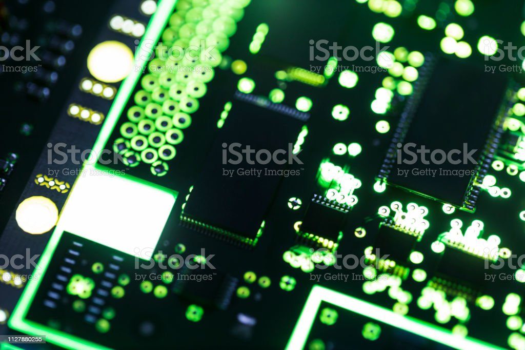 Close-up image of green illuminated computer circuit board.