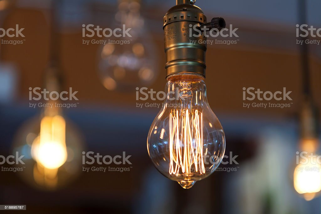 glowing heated filament tungsten lamps stock photo