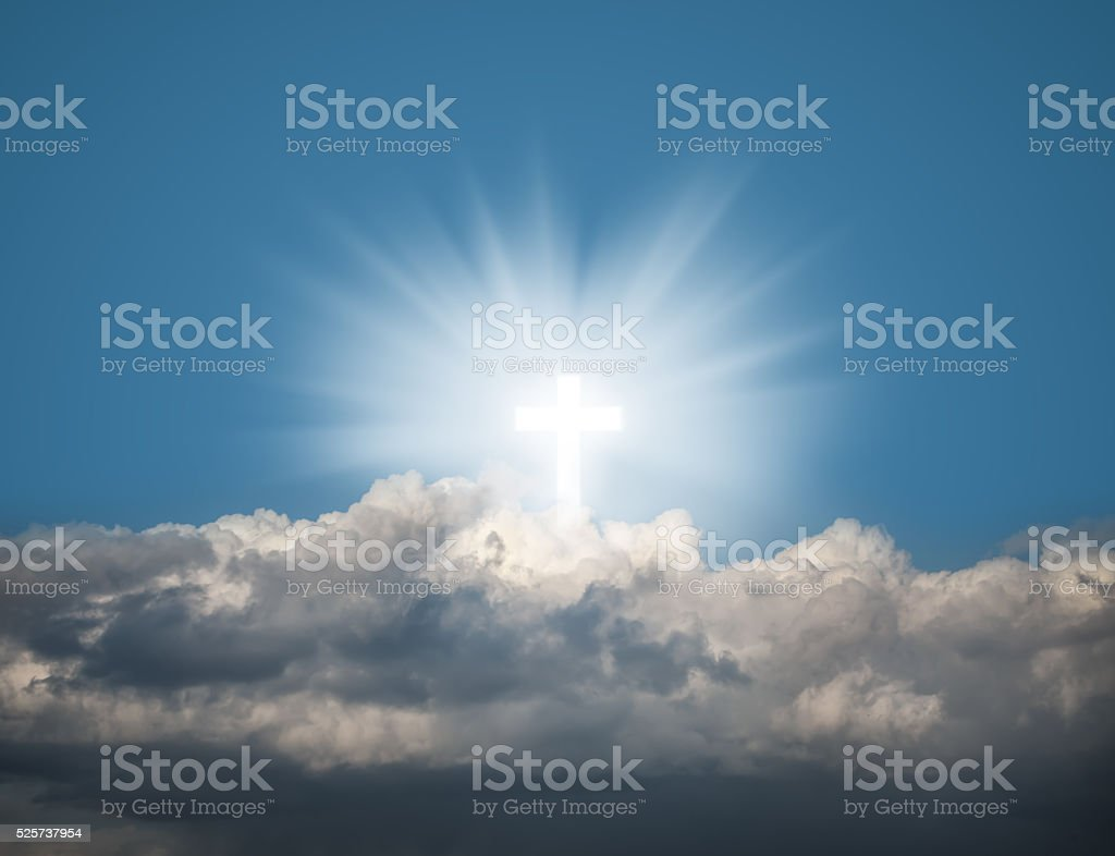 Glowing holy cross in the blue  sky stock photo