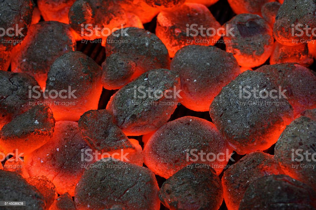 Glowing Hot Charcoal Briquettes Close-up Background Texture stock photo