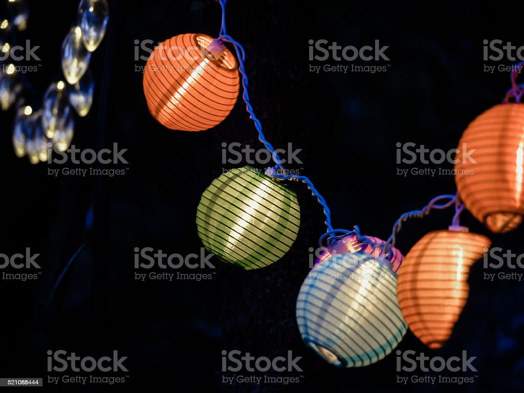 Glowing Japanese Lantern Style Colorful Electric Outdoor String Lights royalty-free stock photo  sc 1 st  iStock & Glowing Japanese Lantern Style Colorful Electric Outdoor String ...