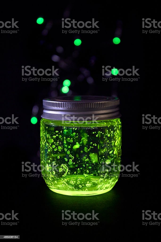 Glowing jar in the darkness stock photo