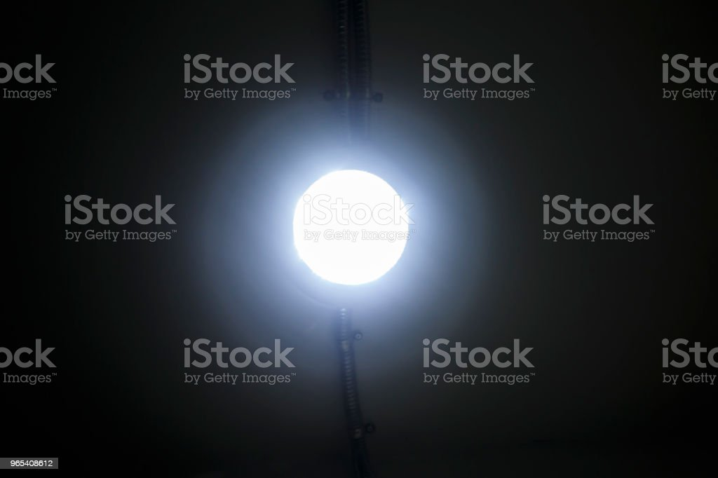 glowing lamp with halo isolated on the ceiling royalty-free stock photo