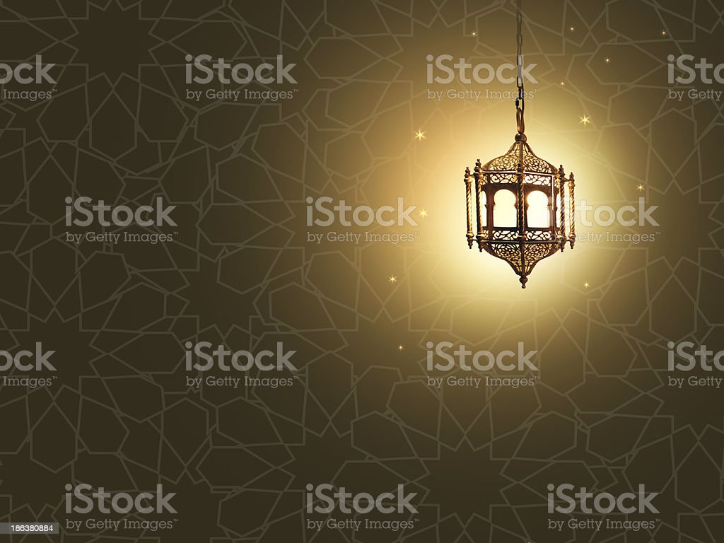 glowing lantern with arabic textured background stock photo