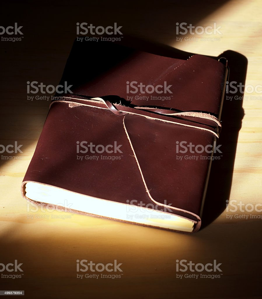 glowing leather bound book stock photo