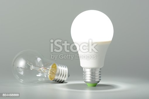 istock Glowing led lamp and incandescent bulb 854468888