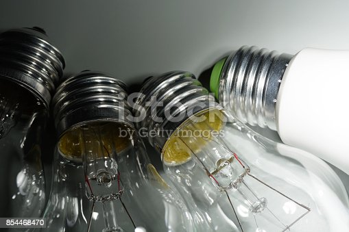 854468792 istock photo Glowing led lamp and incandescent bulbs in the dark 854468470