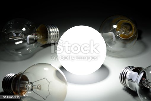 854468792 istock photo Glowing led lamp and incandescent bulbs in the dark 854468622