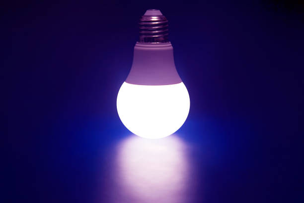 Glowing LED lamp on a dark blue background. Modern technology and electricity stock photo