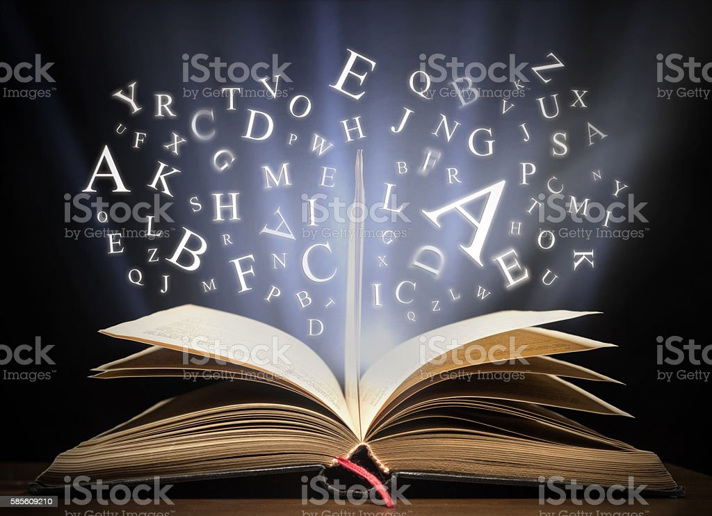 Glowing letters on book light stock photo
