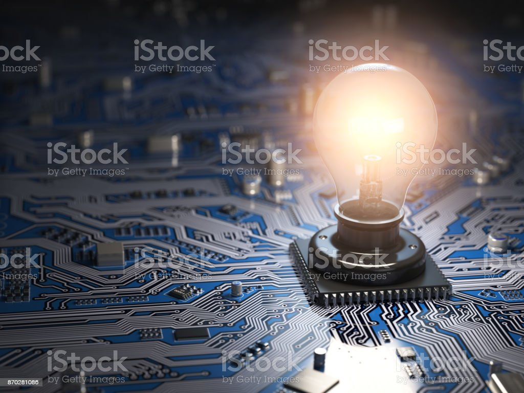 Glowing light bulb as CPU on motherboard circuit board. Idea creativity business concept. stock photo