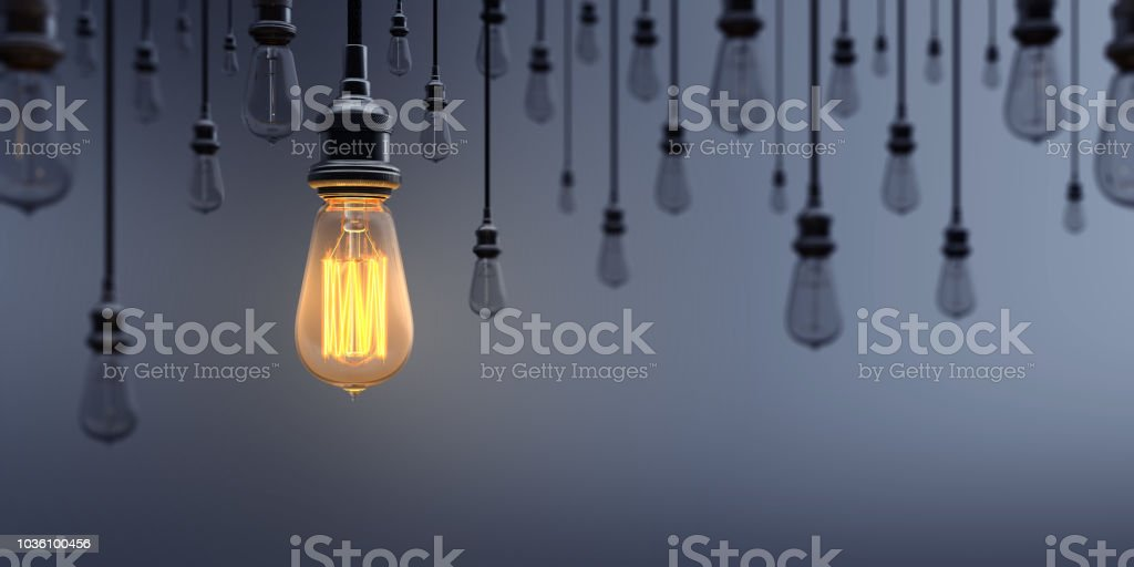 Glowing Light Bulb Standing Out From the Crowd royalty-free stock photo