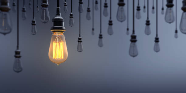 glowing light bulb standing out from the crowd - leadership stock pictures, royalty-free photos & images