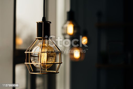 istock Glowing light bulbs in the loft style 1137999886